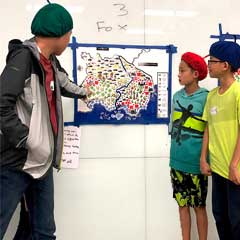 CTY students looking at a map