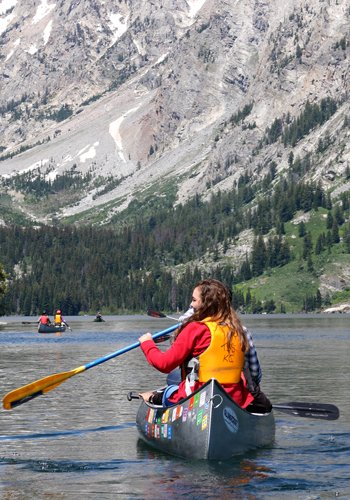 Young person canoeing in Wyoming.