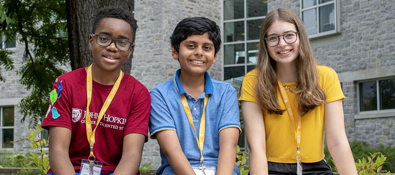 Three middle-school aged CTY students