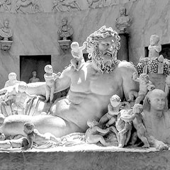 statue of a man surrounded by cherubs