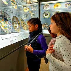 two cty students looking at a display in the metropolitan museum of art